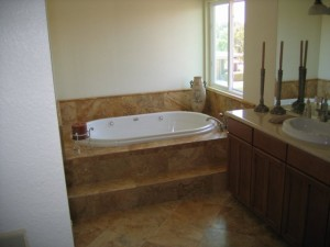 Second Story addition, M. Bath travertine tile and granite counters