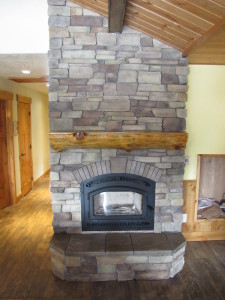 Stone wrapped fireplace