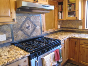 Custom backsplash with tumbled marble stone tile and slate tile